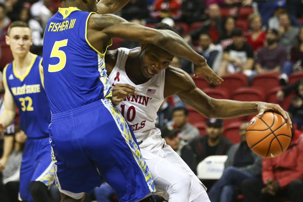 UNLV Rebels forward Shakur Juiston (10) drives against San Jose State Spartans forward Keith Fisher III (5) during a basketball game at the Thomas & Mack Center in Las Vegas on Wednesday, Jan. ...