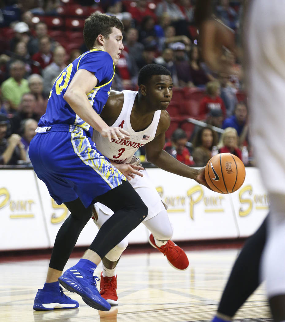 UNLV Rebels guard Amauri Hardy (3) drives against San Jose State Spartans guard Noah Baumann (20) during a basketball game at the Thomas & Mack Center in Las Vegas on Wednesday, Jan. 31, 2018. ...