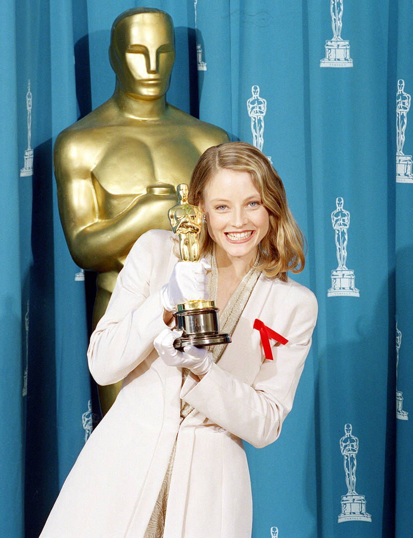 "Jodie Foster shows off her Oscar backstage at the 64th annual Academy Awards in Los Angeles, Ca., March 30, 1992.  Foster won best actress in a leading role for her performance in ""Silenc ..."