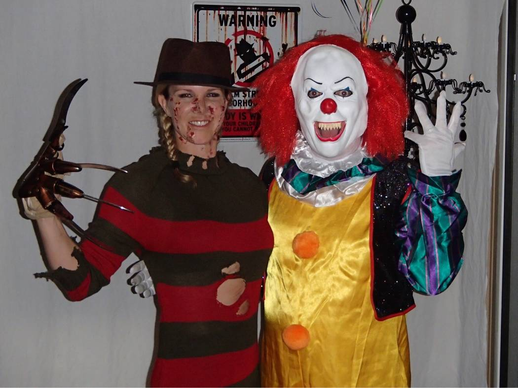 Jill Oliver and Michael Worley pose as Freddy Krueger and Pennywise the Dancing Clown at their annual Halloween party. (Courtesy)