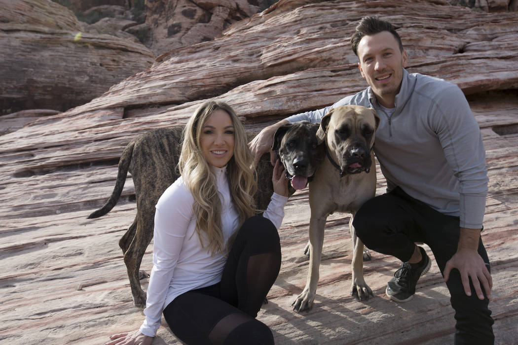 Megan Fazio and James Probst with their dogs Minnie, left, and Xena on a trail near Red Springs picnic area in Red Rock Canyon National Conservation Area Thursday, Feb. 1, 2018. The couple met whi ...