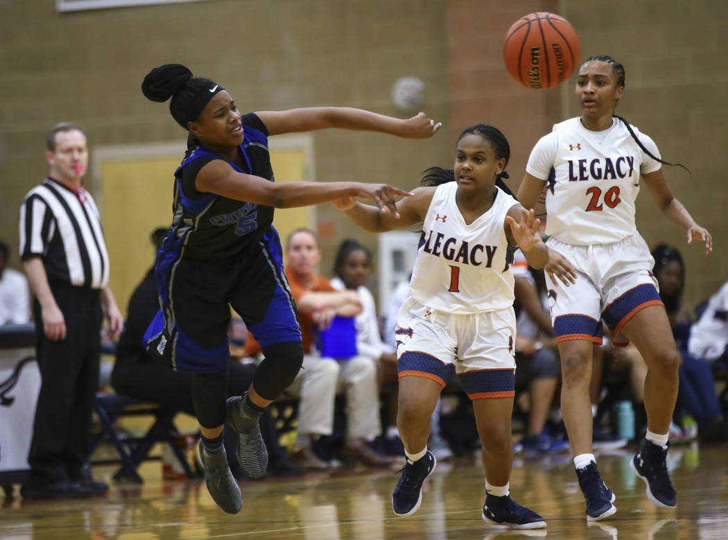 Cheyenne's Shanice Aycox (5) throws a pass as Legacy's Samiah Mitchell (1) and Legacy's Amiya DeSouza (20) look on during a basketball game at Legacy High School in Las Vegas on Thursday, Feb. 1,  ...