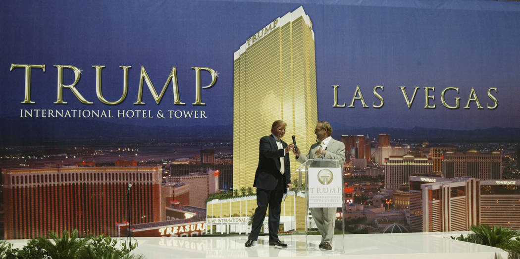 Kansas billionaire businessman Phil Ruffin, right, hands the microphone over to  Donald Trump, Tuesday, July 12, 2005 in Las Vegas during a ceremony to mark the start of  the 64-story hotel and ap ...