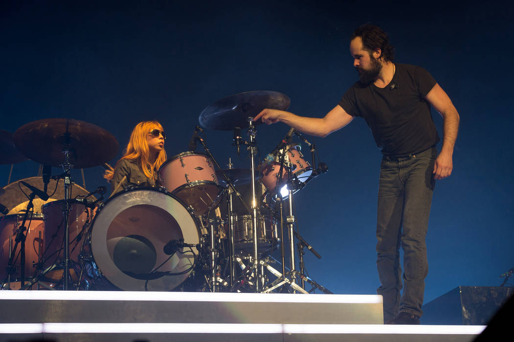 "Drummer Ronnie Vannucci Jr. and The Killers invite a fan on stage to play drums on ""For Reasons Unknown"" during Saturday's show at the MGM Grand Garden. (Rob Loud)"
