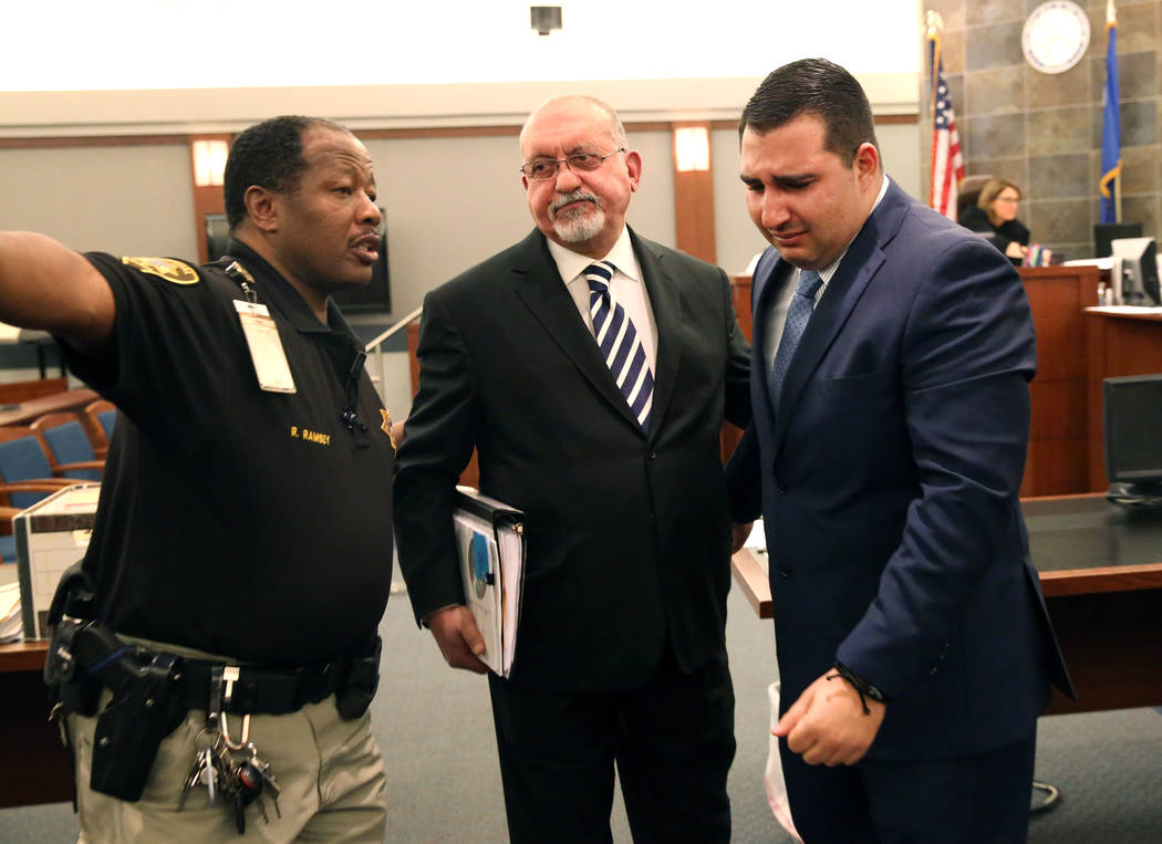 Raad Sunna, right, overwhelmed with emotion as he leaves the courtroom with his attorney Dominic Gentile, center, at the Regional Justice Center on Thursday, Feb. 1, 2017, in Las Vegas. Sunna, smo ...
