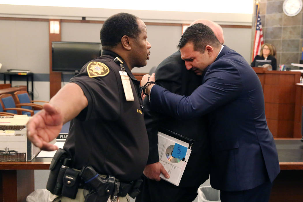 Raad Sunna, right, overwhelmed with emotion as he hugs his attorney Dominic Gentile at the Regional Justice Center on Thursday, Feb. 1, 2017, in Las Vegas. Sunna, smoke shop clerk who pleaded guil ...