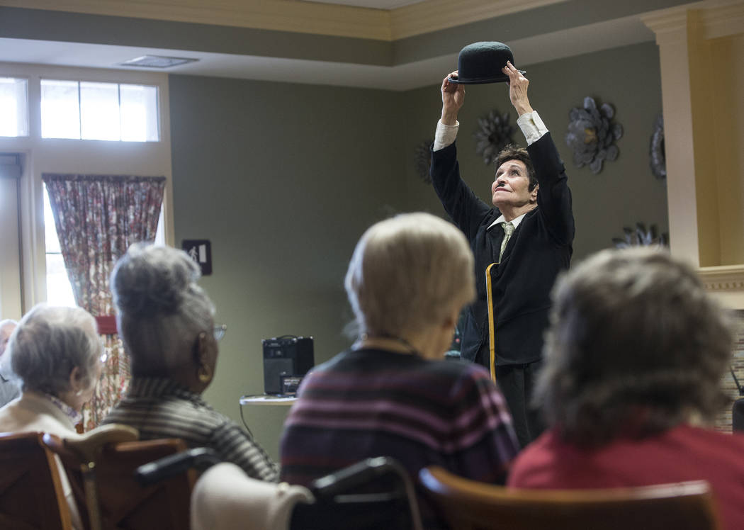 De Carny, right, portrays Charlie Chaplin during an event hosted by the Ms. Senior Nevada organization at The Bridge at Paradise Valley on Tuesday, January 30, 2018, in Las Vegas. Benjamin Hager L ...