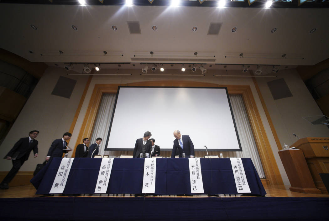 Japanese video game maker Nintendo Co. President Tatsumi Kimishima, right, and other executive officers prepare to attend a news conference during in Tokyo Thursday, Feb. 1, 2018.  Japanese video- ...