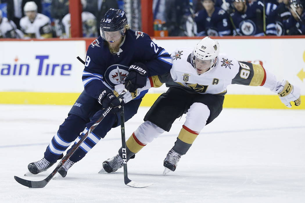 Vegas Golden Knights' Nate Schmidt (88) chases down Winnipeg Jets' Patrik Laine (29) during the second period of an NHL hockey game Thursday, Feb. 1, 2018, in Winnipeg, Manitoba. (John Woods/The C ...