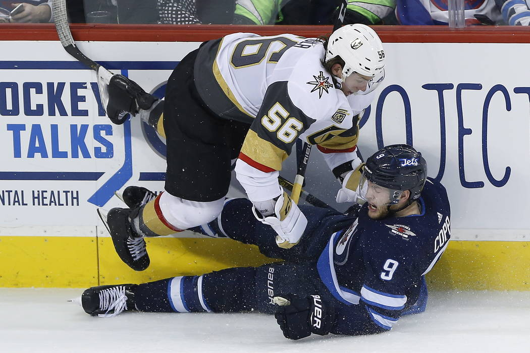 Vegas Golden Knights Erik Haula (56) and Winnipeg Jets' Andrew Copp (9) collide during the third period of an NHL hockey game Thursday, Feb. 1, 2018, in Winnipeg, Manitoba. (John Woods/The Canadia ...