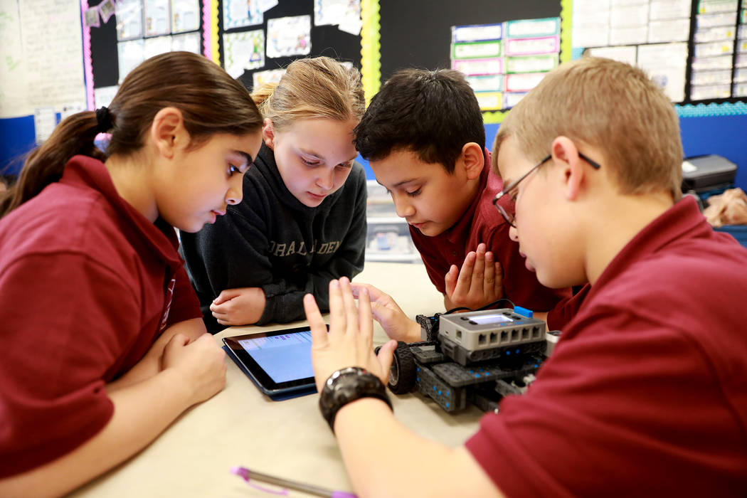 Aya Damaj, 10, from left, Katie Yant, 11, Liam Bleuer, 10, and Luke Stringer, 10, design a robot that can be controlled remotely during class on Thursday, Feb. 1, 2018, at Coral Academy of Scien ...