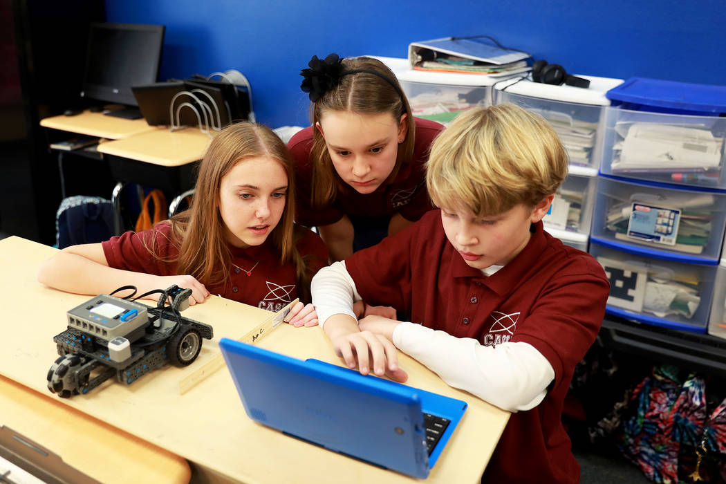 Olivia Denofa, 11, from left, Peyton Glover, 11, and Ralph Goodwin, 10, design a robot that can be controlled remotely during class on Thursday, Feb. 1, 2018, at Coral Academy of Science in Las Ve ...