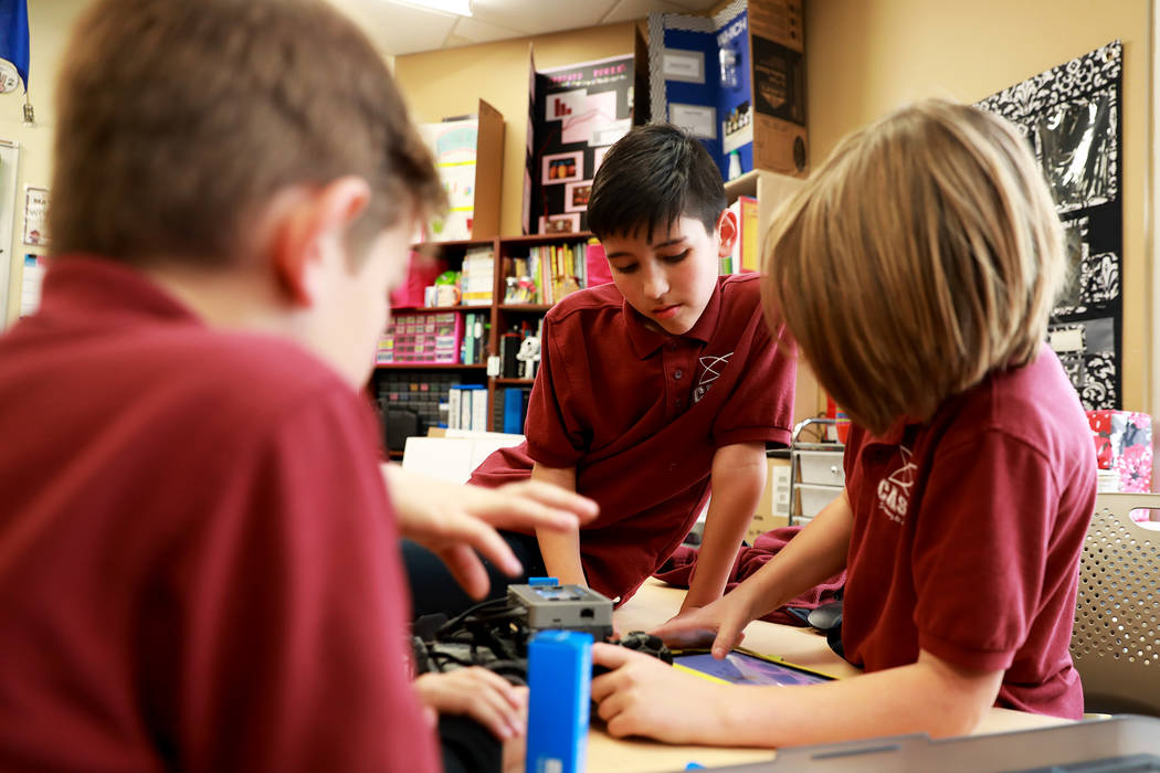 Ryann Crothers, 10, center, works with his group to design a robot that can be controlled remotely during class on Thursday, Feb. 1, 2018, at Coral Academy of Science in Las Vegas. Andrea Corne ...