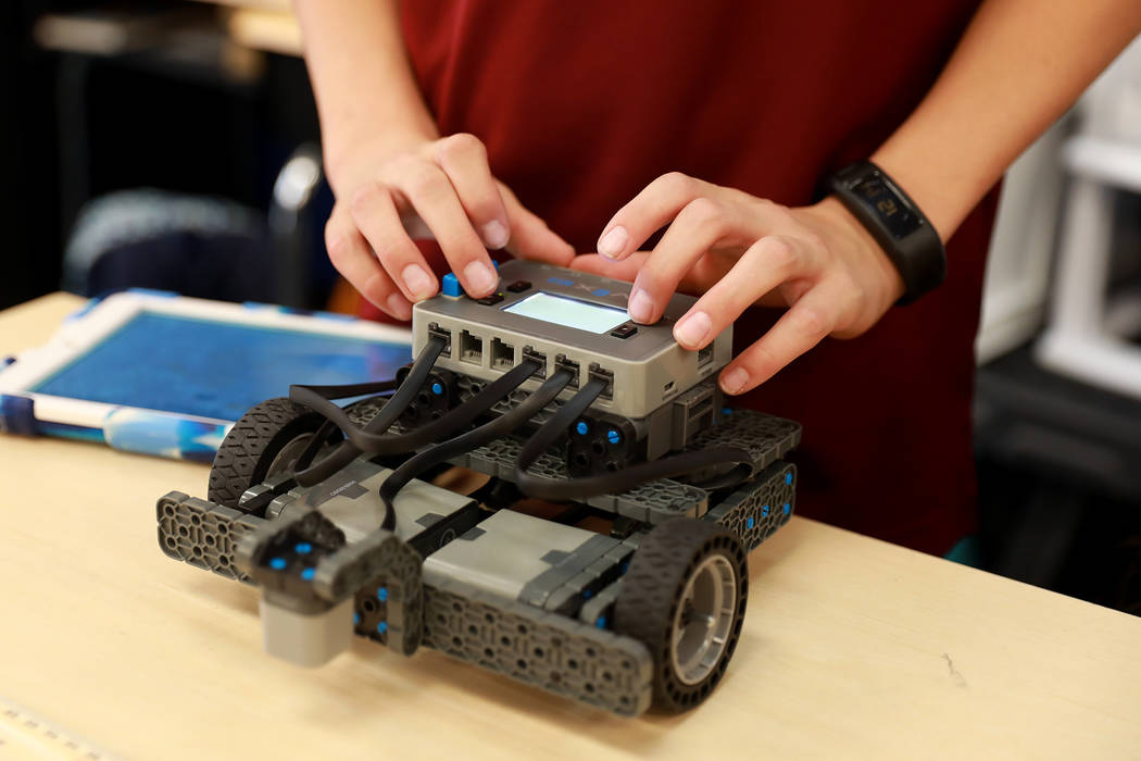 Owen Kirpes, 11, downloads the program unto his robot during Project Lead the Way, a science, technology, engineering, arts and math program that combines the Next Generation Science Standards wit ...