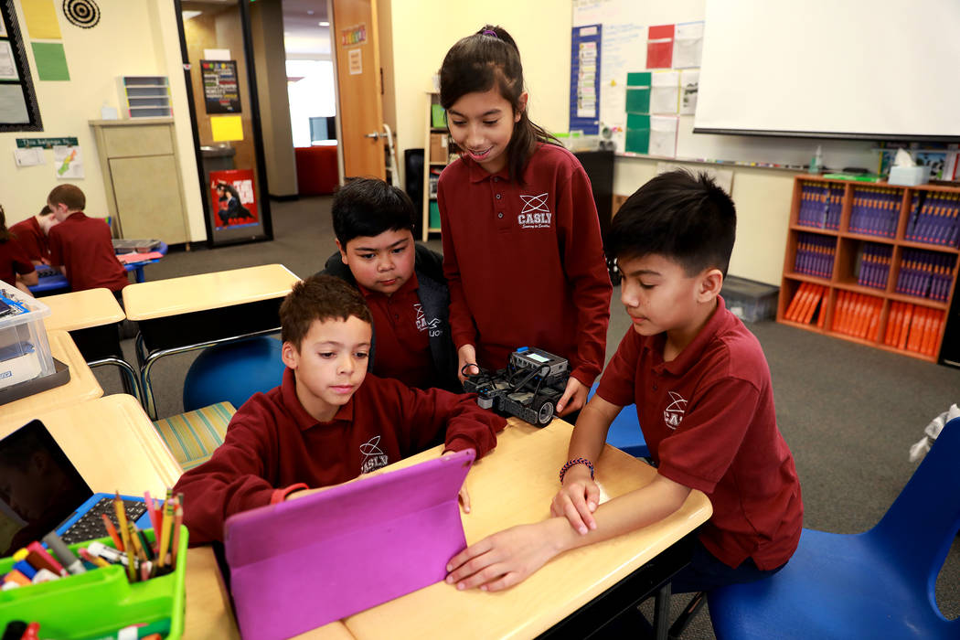 Tyson Leland, 10, from left, Sam Cardiel, 11, a student who wished to not be identified, and Salman Shah, 11, design a robot that can be controlled remotely during class on Thursday, Feb. 1, 2018, ...