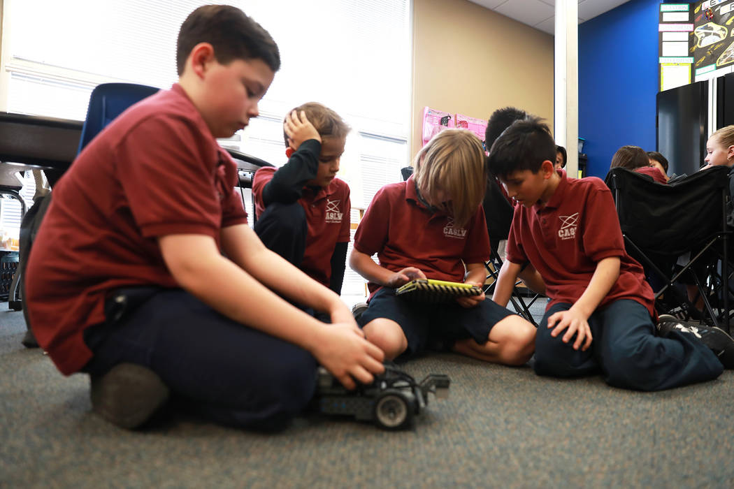 Justin Spahr, 11, from left, Jackson Ormonde, 10, Jake Leppelmeier, 10, and Ryann Crothers, 10, design a robot that can be controlled remotely during class on Thursday, Feb. 1, 2018, at Coral A ...