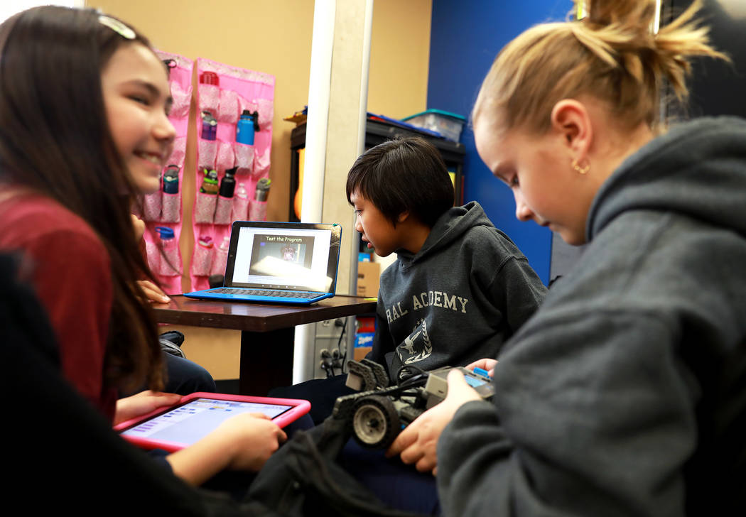 Alexander Magallanes, 10, center, helps his group design a robot that can be controlled remotely during class on Thursday, Feb. 1, 2018, at Coral Academy of Science in Las Vegas.  Andrea Cornej ...
