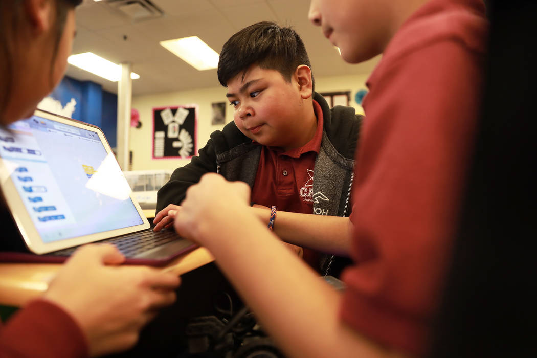 Sam Cardiel, 11, helps his group build a robot during class on Thursday, Feb. 1, 2018, at Coral Academy of Science in Las Vegas. Andrea Cornejo Las Vegas Review-Journal @DreaCornejo
