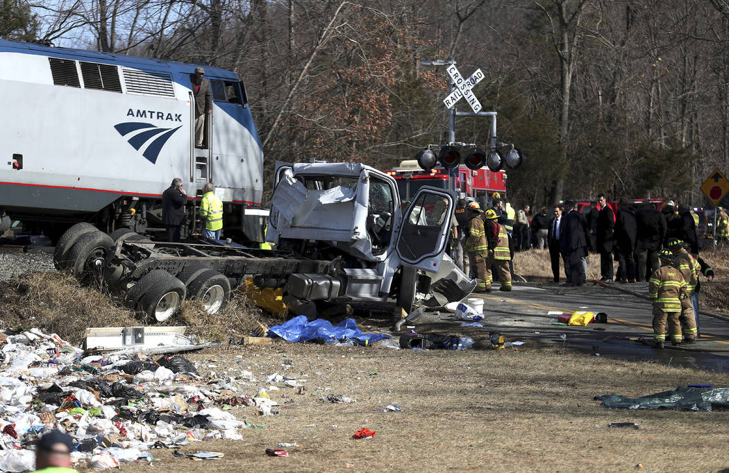 Emergency personnel work at the scene of a train crash involving a garbage truck in Crozet, Va., on Wednesday, Jan. 31, 2018. An Amtrak passenger train carrying dozens of GOP lawmakers to a Republ ...