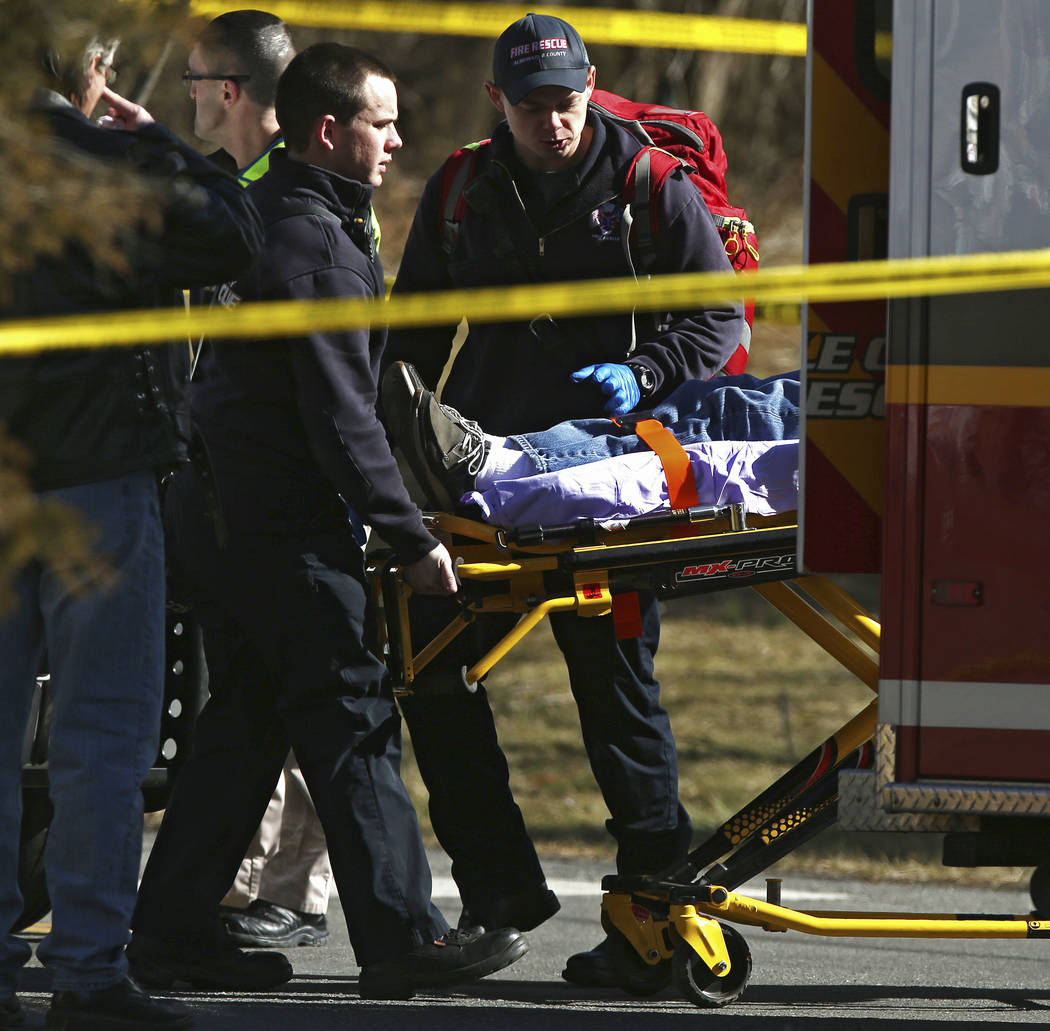 Emergency personnel load an injured person into an ambulance near the scene of where an Amtrak train carrying multiple Republican lawmakers crashed into a garbage truck  in Crozet, Va., on Wednesd ...