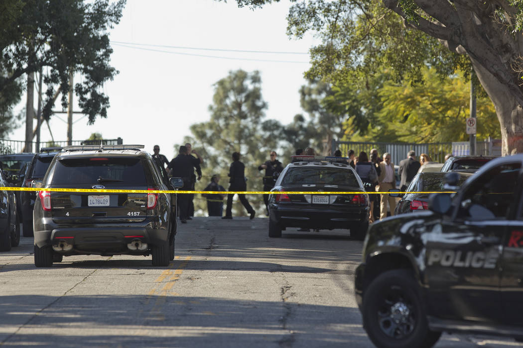 Los Angeles Police cordon off Salvador B. Castro Middle School in Los Angeles Thursday, Feb. 1, 2018. Two students were shot and wounded, one critically, inside a  classroom Thursday morning, and  ...
