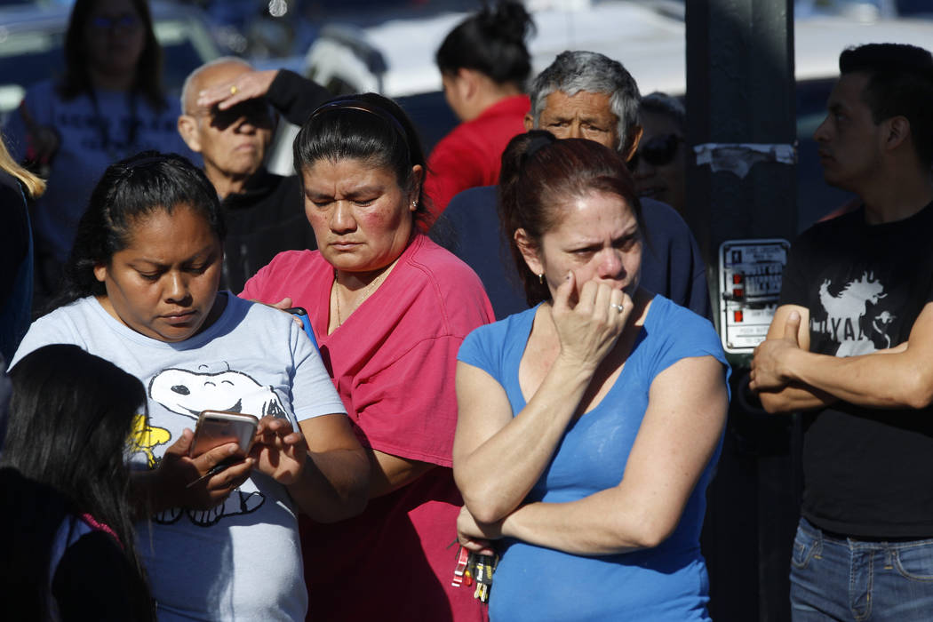 Parents wait for news of students at Salvador B. Castro Middle School in Los Angeles Thursday, Feb. 1, 2018. Two students were shot and wounded, one critically, inside a classroom Thursday morning ...