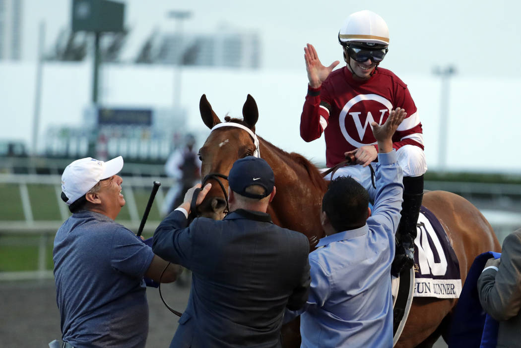 Jockey Florent Geroux is congratulated after riding Gun Runner to win the Pegasus World Cup Invitational horse race, Saturday, Jan. 27, 2018, at Gulfstream Park in Hallandale Beach, Fla. (AP Photo ...