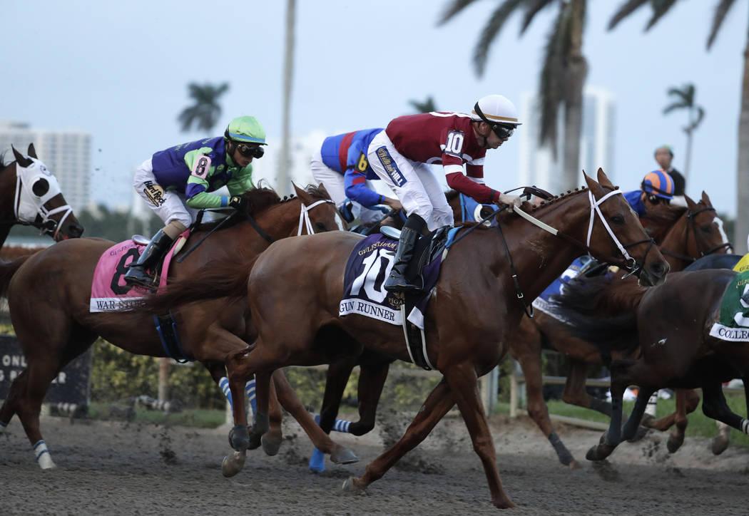 Jockey Florent Geroux, (10) rides Gun Runner during the Pegasus World Cup Invitational horse race, Saturday, Jan. 27, 2018, at Gulfstream Park in Hallandale Beach, Fla. Gun Runner won the race. (A ...