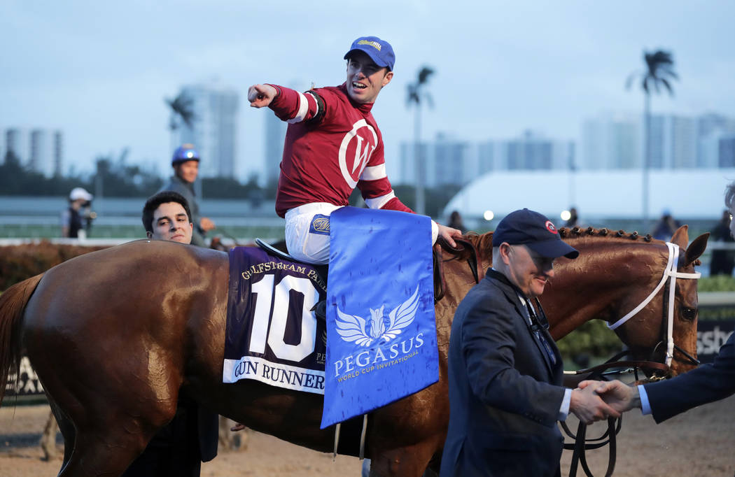 Jockey Florent Geroux reacts after riding Gun Runner to win the Pegasus World Cup Invitational horse race, Saturday, Jan. 27, 2018, at Gulfstream Park in Hallandale Beach, Fla. (AP Photo/Lynne Sladky)