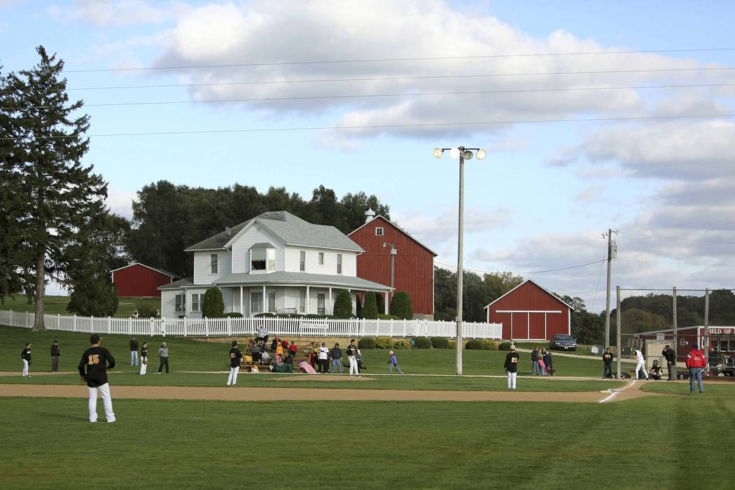 "Teams play at the ""Field of Dreams"" during a fall tournament in Dyersville, Iowa, Oct. 2, 2014. A  man has turned himself in saying he drove onto the field and caused thousands of dollars in damag ..."
