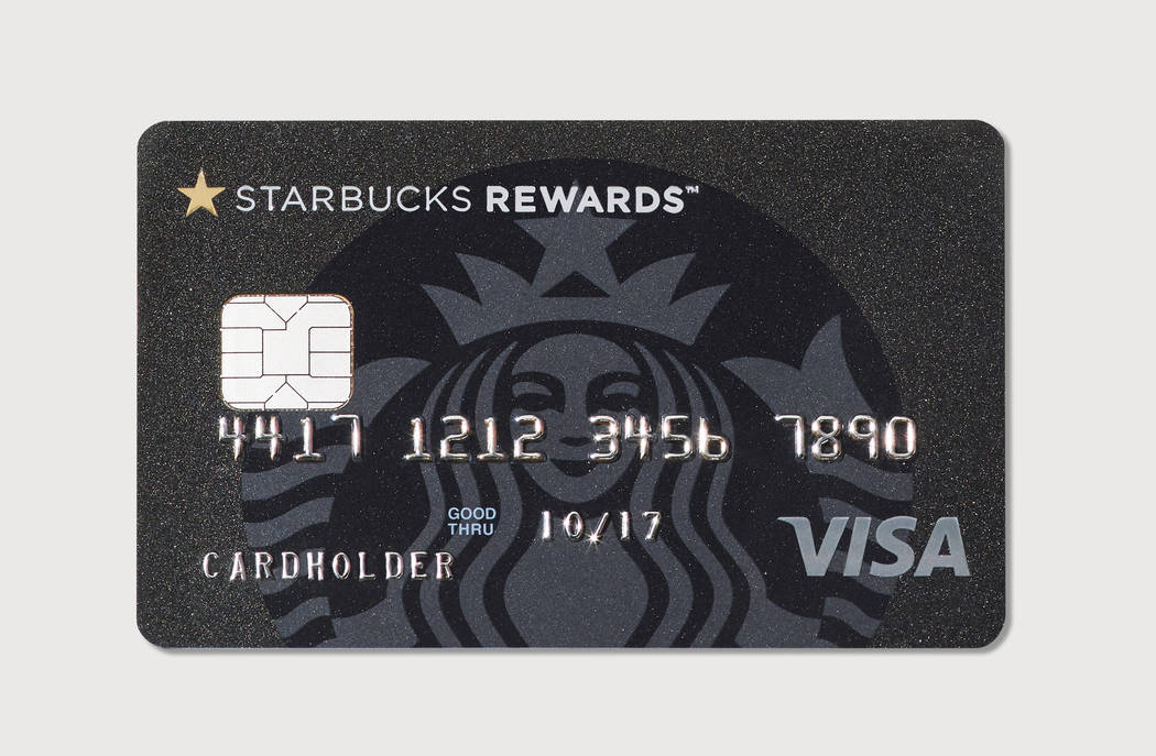 This image provided by Starbucks shows the new Starbucks Rewards credit card, launched in cooperation with JPMorgan Chase and Visa. The Starbucks Rewards credit card has a $49 annual fee and lets  ...