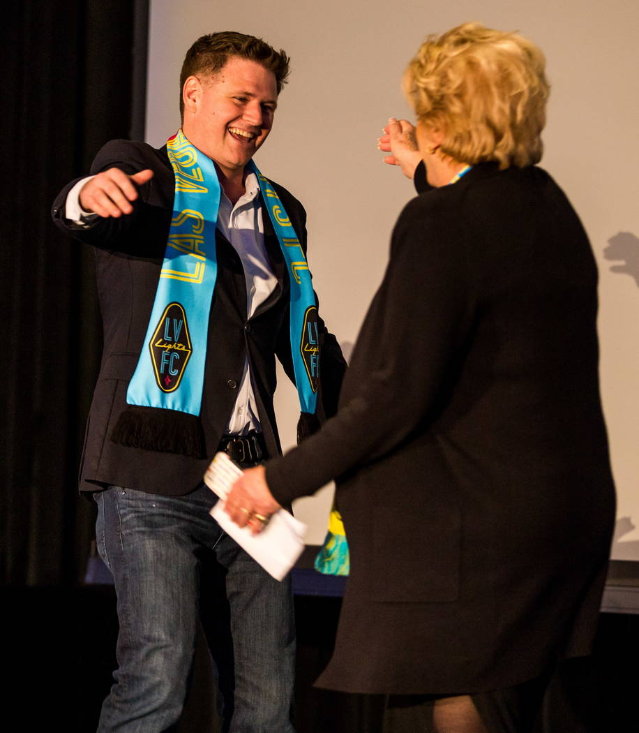 Las Vegas Lights FC soccer team owner Brett Lashbrook and Mayor Carolyn Goodman greet each other during jersey reveal event at the Zappos Downtown campus on Las Vegas Boulevard on Wednesday, Feb.  ...