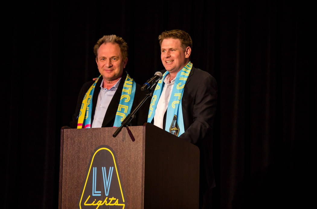 Las Vegas Lights FC soccer team owner Brett Lashbrook, right, introduces Findlay Toyota general manager John Barr during a jersey reveal event at the Zappos Downtown campus on Las Vegas Boulevard  ...