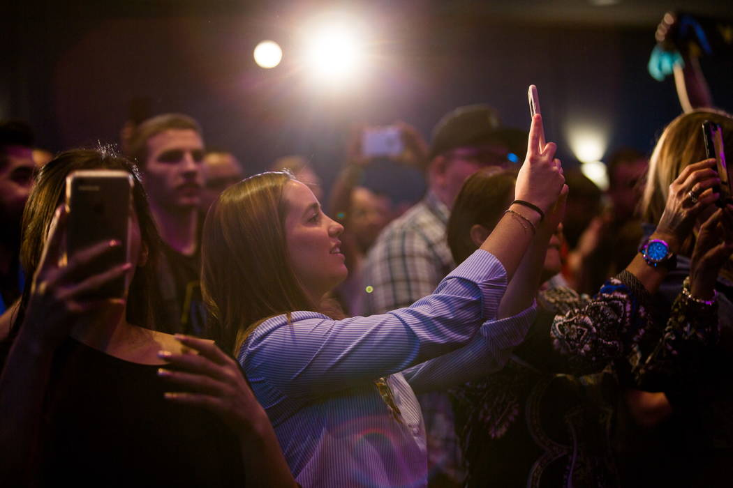 Fans snap pictures from the audience during a jersey reveal for the Las Vegas Lights FC soccer team at the Zappos Downtown campus on Las Vegas Boulevard on Wednesday, Feb. 7, 2018.  Patrick Connol ...