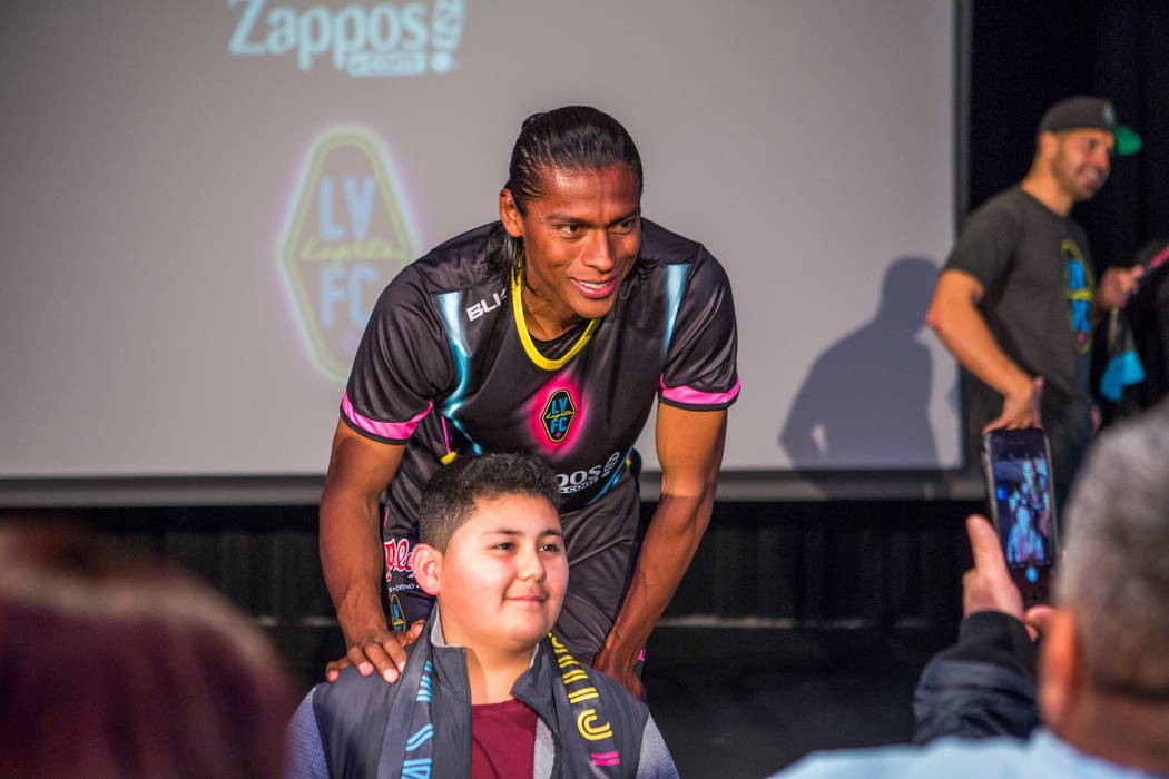 Joel Huiqui has his photo taken with a fan during a jersey reveal for the Las Vegas Lights FC soccer team at the Zappos Downtown campus on Las Vegas Boulevard on Wednesday, Feb. 7, 2018.  Patrick  ...