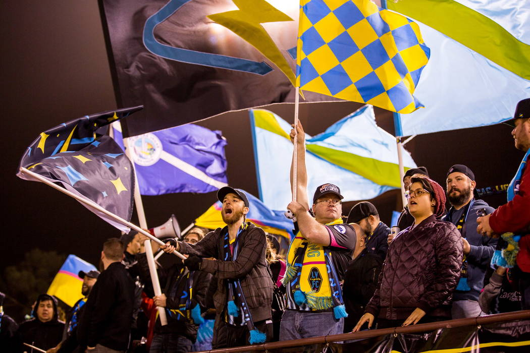 Fans cheer and wave flags before the first Las Vegas Lights FC game at Cashman Field in Las Vegas on Saturday, Feb. 10, 2018.  Patrick Connolly Las Vegas Review-Journal @PConnPie