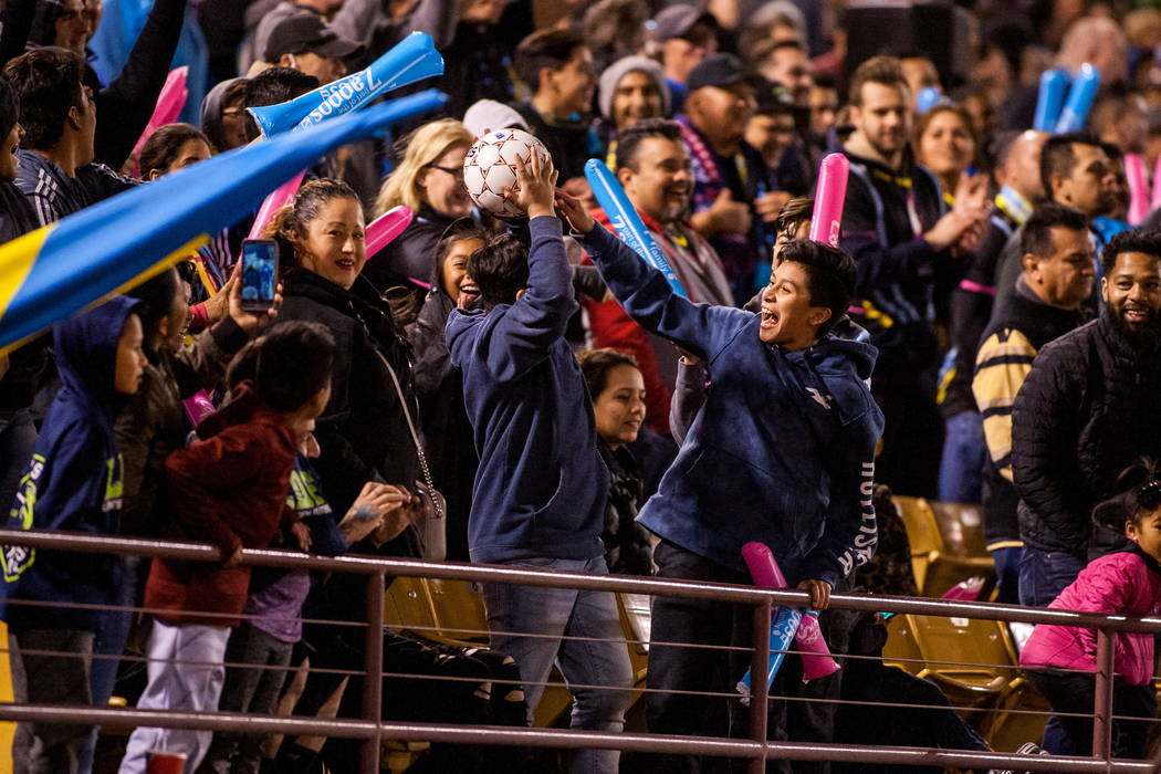An excited fan catches a stray ball during the first Las Vegas Lights FC game playing against the Montreal Impact at Cashman Field in Las Vegas on Saturday, Feb. 10, 2018.  Patrick Connolly Las Ve ...