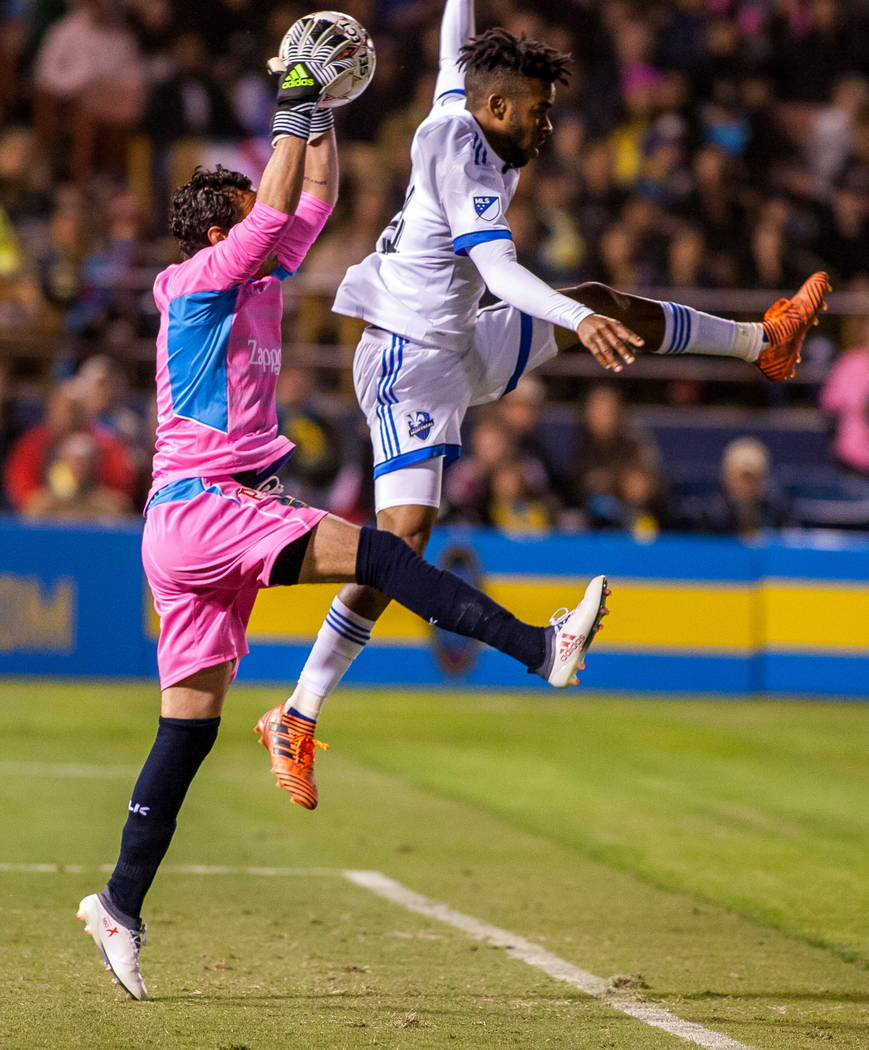 Las Vegas Lights' goalkeeper Ricardo Ferrino grabs the ball while Montreal's Raheem Edwards tries to intercept during the first Las Vegas Lights FC game at Cashman Field in Las Vegas on Saturday,  ...