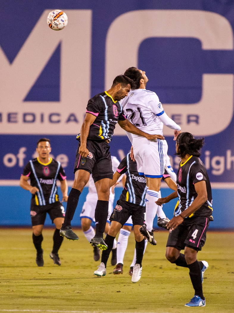 Players compete for a head butt during the first Las Vegas Lights FC game playing against the Montreal Impact at Cashman Field in Las Vegas on Saturday, Feb. 10, 2018.  Patrick Connolly Las Vegas  ...