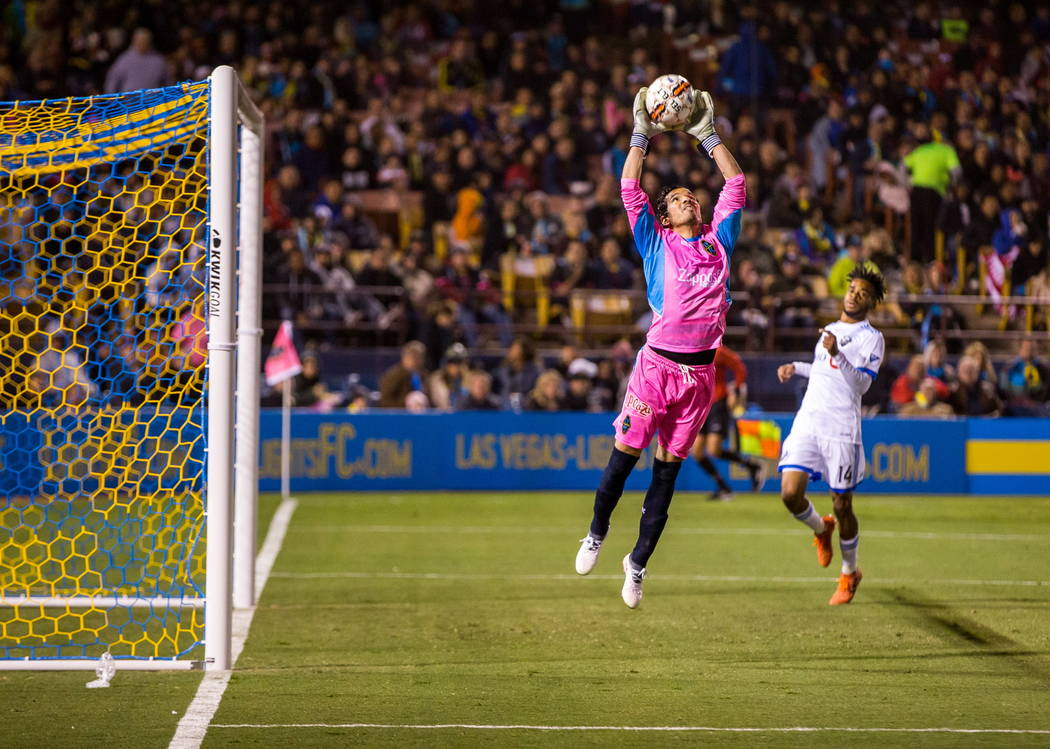 Las Vegas Lights' goalkeeper Ricardo Ferrino grabs the ball while playing against Montreal Impact during the first Las Vegas Lights FC game at Cashman Field in Las Vegas on Saturday, Feb. 10, 2018 ...