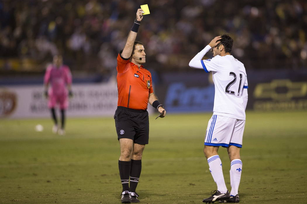 Montreal Impact's Matteo Mancosu (21) receives a yellow card in the exhibition match against the Las Vegas Light FC at Cashman Field in Las Vegas, Saturday, Feb. 10, 2018. Erik Verduzco Las ...