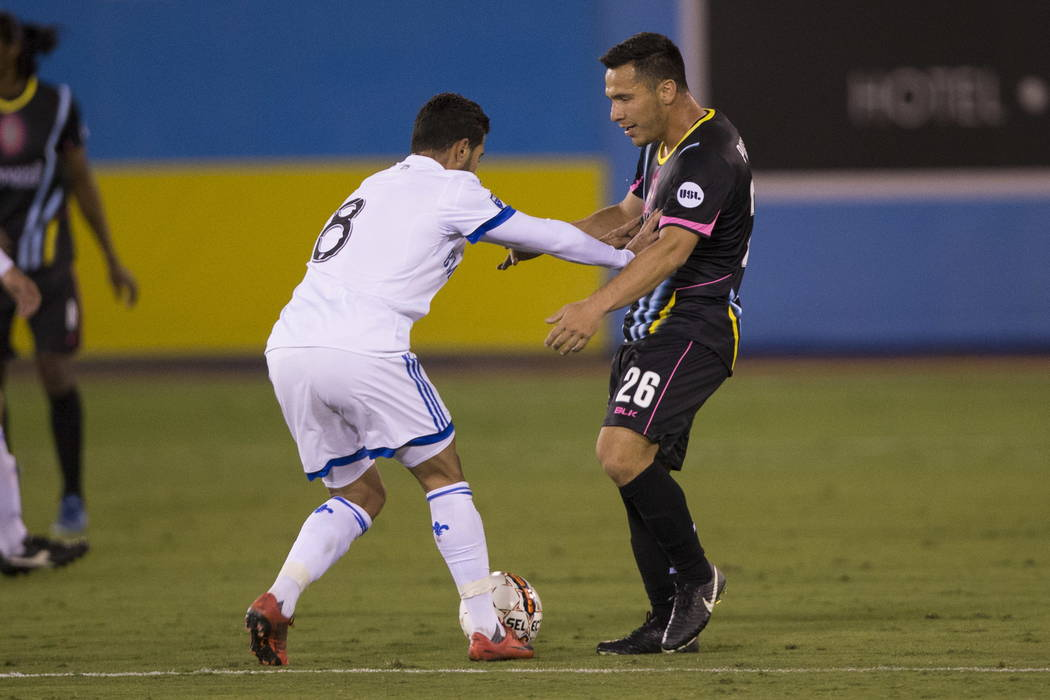 Montreal Impact's Saphir Taider (8) pushes Las Vegas Lights FC Marcelo Julian Portugal (26) during the exhibition match at Cashman Field in Las Vegas, Saturday, Feb. 10, 2018. Montreal won  ...