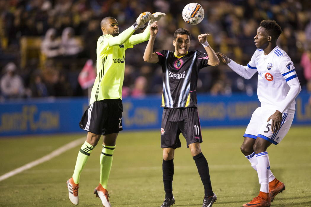 Las Vegas Lights FC Marcelo Oscar Hernandez (11) goes for the ball against Montreal Impact's Cle´ment Diop (23) and Zakaria Diallo (5) during the exhibition match at Cashman Field in L ...