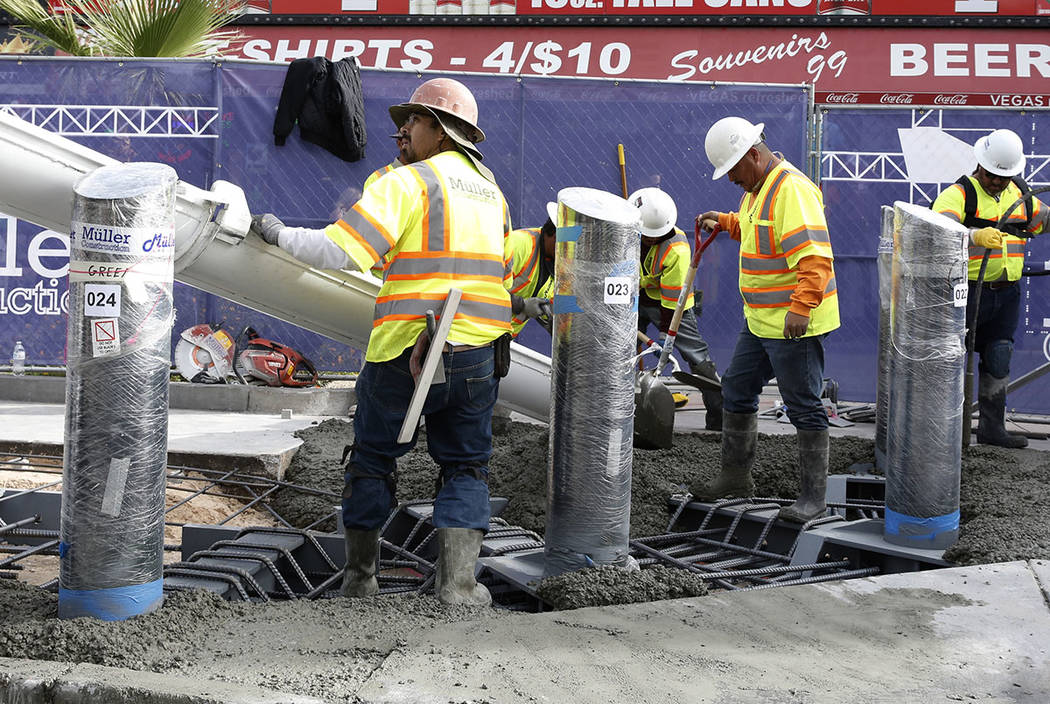 Construction crews pour cement where they began installing steel posts on the Strip near Aria hotel-casino Monday, Nov. 13, 2017 to protect pedestrians, locals and tourists walking along Las Vegas ...