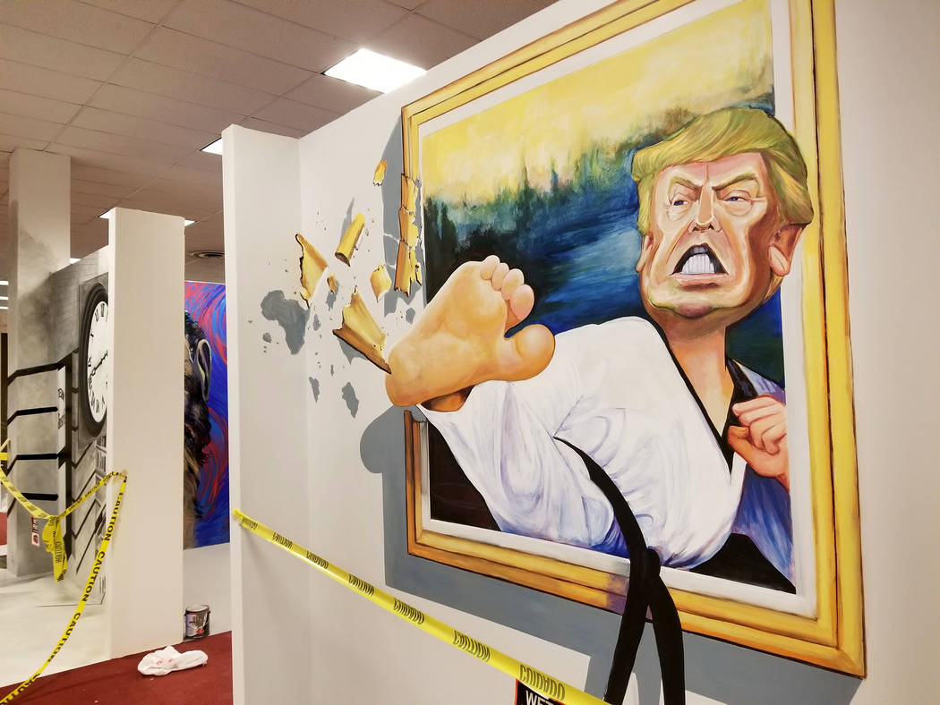 A 3-D art shows Donald Trump sidekicking his way out of a picture frame at Boulevard Mall in Las Vegas, Thursday, Feb. 1, 2018. A new entertainment complex at Boulevard Mall will have about 60 mur ...