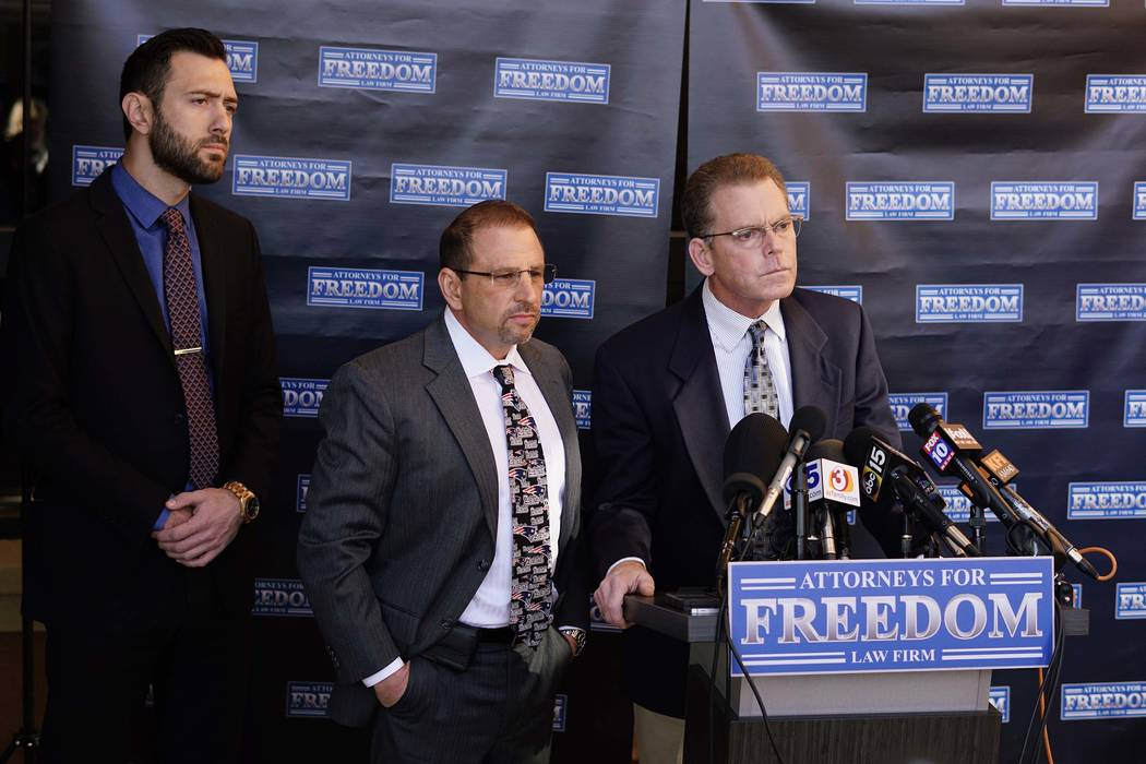"Douglas Haig, right, the man who was identified this week as a ""person of interest"" in the Las Vegas shooting investigation, speaks at a press conference with his attorney, Marc J. Victor, cen ..."