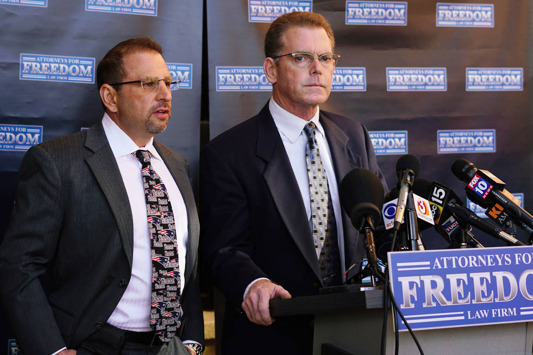 "Douglas Haig, right, the man who was identified this week as a ""person of interest"" in the Las Vegas shooting investigation, speaks at a news conference with his attorney, Marc J. Victor, center,  ..."