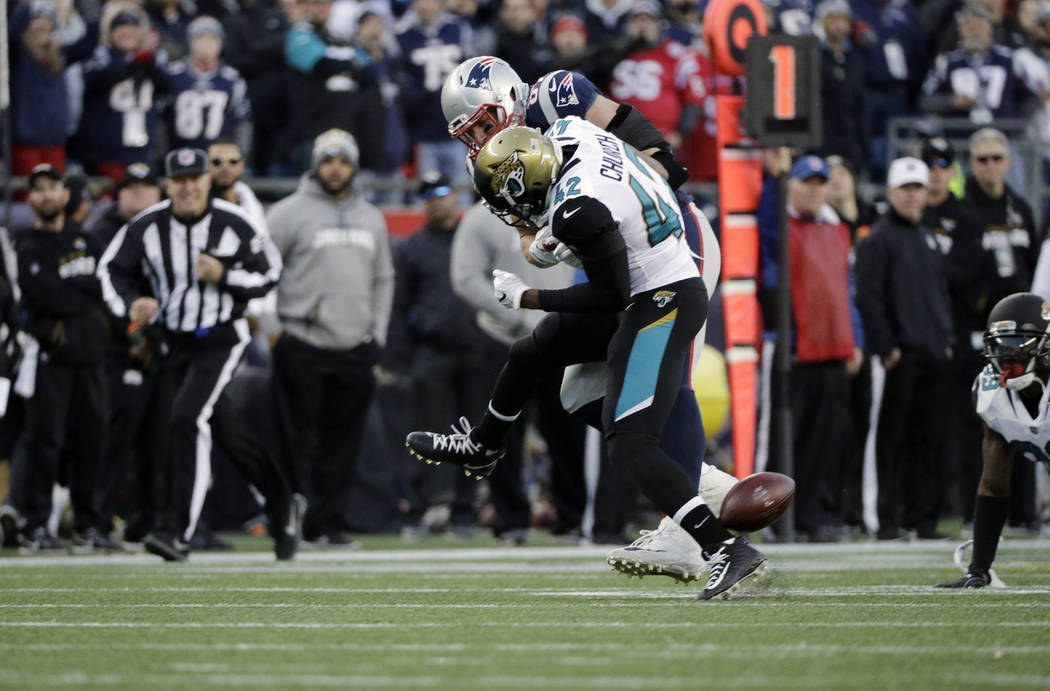 New England Patriots tight end Rob Gronkowski (87) is hit by Jacksonville Jaguars safety Barry Church (42) during the first half of the AFC championship NFL football game, Sunday, Jan. 21, 2018, i ...