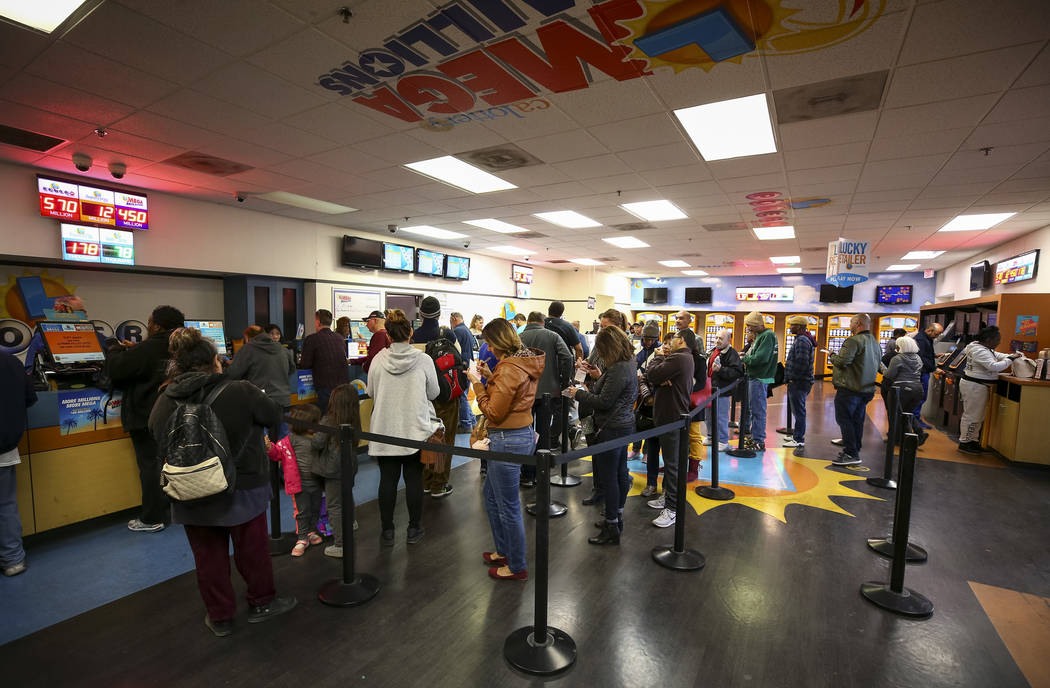 Customers stand in line to buy lottery tickets at The Lotto Store at Primm just inside the California border next to the Primm Valley Casino Resorts on Friday, January 5, 2018. Richard Brian Las V ...