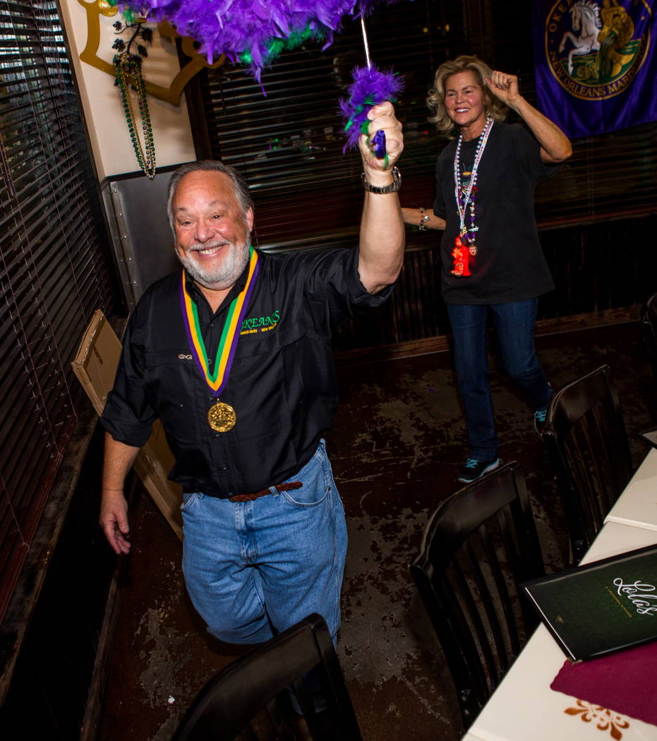 The Krewe of Okeanos, led by king Marc Vennart, followed by his wife, Joan Vennart, celebrate before leaving for New Orleans Mardi Gras at Lola's in Summerlin on Saturday, Feb. 3, 2018.  Patrick C ...
